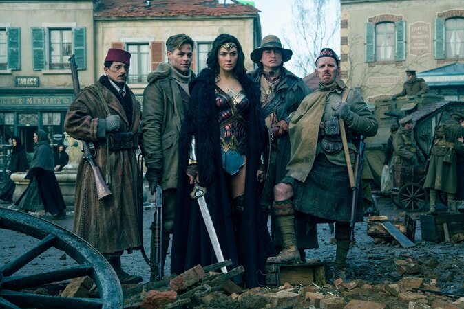 "SAÏD TAGHMAOUI as Sameer, CHRIS PINE as Steve Trevor, GAL GADOT as Diana, EUGENE BRAVE ROCK as The Chief and EWEN BREMNER as Charlie in the action adventure ""WONDER WOMAN,"" a Warner Bros. Pictures release."