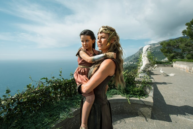 "LILLY ASPELL as Young Diana and CONNIE NIELSEN as Hippolyta in the action adventure ""WONDER WOMAN,"" a Warner Bros. Pictures release."