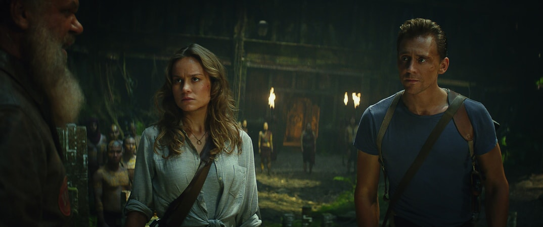 "BRIE LARSON as Mason Weaver and TOM HIDDLESTON as James Conrad in Warner Bros. Pictures', Legendary Pictures' and Tencent Pictures' action adventure ""KONG: SKULL ISLAND,"" a Warner Bros. Pictures release."