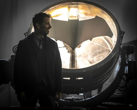 Director Zack Snyder in front of Bat Signal