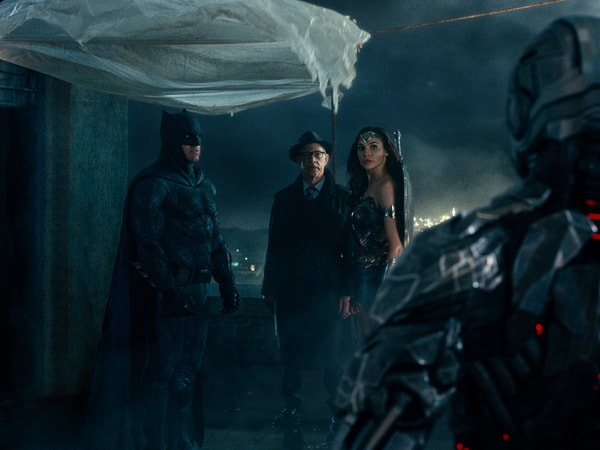 """BEN AFFLECK as Batman, J.K. SIMMONS as Commissioner Gordon, GAL GADOT as Wonder Woman and RAY FISHER as Cyborg in Warner Bros. Pictures' action adventure """"JUSTICE LEAGUE,"""" a Warner Bros. Pictures release."""
