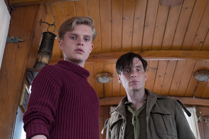 """TOM GLYNN-CARNEY as Peter and CILLIAN MURPHY as Shivering Soldier in the Warner Bros. Pictures action thriller """"DUNKIRK,"""" a Warner Bros. Pictures release."""