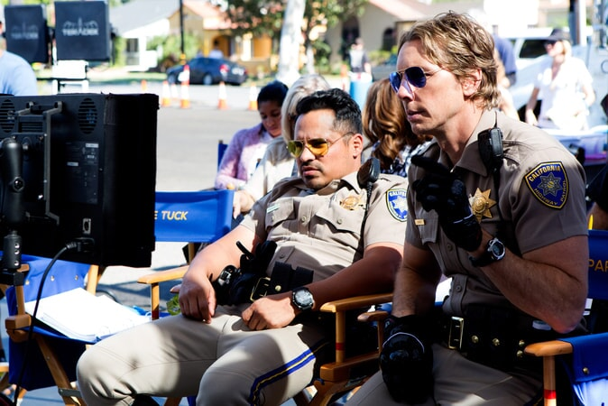 """MICHAEL PEÑA and writer/director/star DAX SHEPARD behind the scenes on Warner Bros. Pictures' action comedy """"CHIPS,"""" a Warner Bros. Pictures release."""