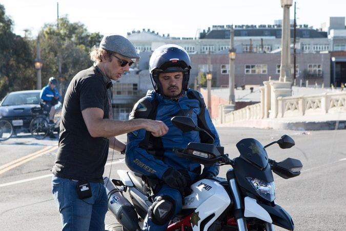 """Writer/director/star DAX SHEPARD and MICHAEL PEÑA behind the scenes on Warner Bros. Pictures' action comedy """"CHIPS,"""" a Warner Bros. Pictures release."""