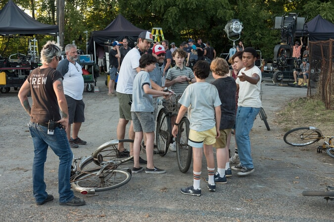 "Director ANDY MUSCHIETTI, FINN WOLFHARD, WYATT OLEFF, JACK DYLAN GRAZER, JEREMY RAY TAYLOR, SOPHIA LILLIS, JAEDEN LIEBERHER and CHOSEN JACOBS on the set of New Line Cinema's horror thriller ""IT,"" a Warner Bros. Pictures release."