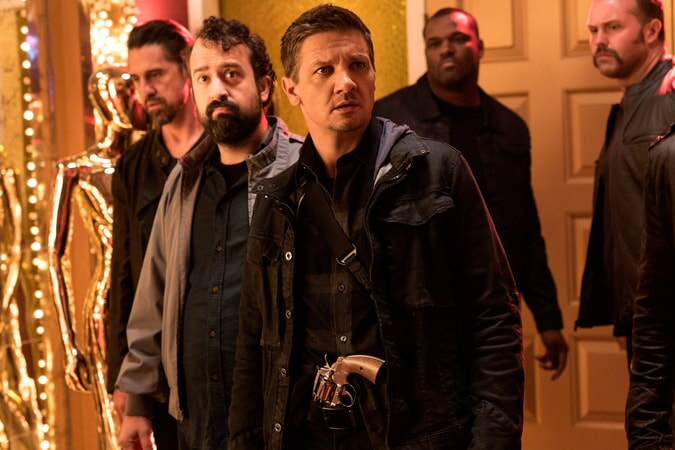 """STEVE ZISSIS as Carl Shackler and JEREMY RENNER as Tommy in the New Line Cinema and Village Roadshow Pictures comedy """"THE HOUSE,"""" a Warner Bros. Pictures release."""