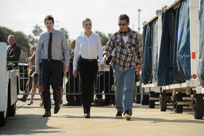 "JIM STURGESS, ABBIE CORNISH and director DEAN DEVLIN on the set of Warner Bros. Pictures' and Skydance's suspense thriller ""GEOSTORM,"" a Warner Bros. Pictures release."