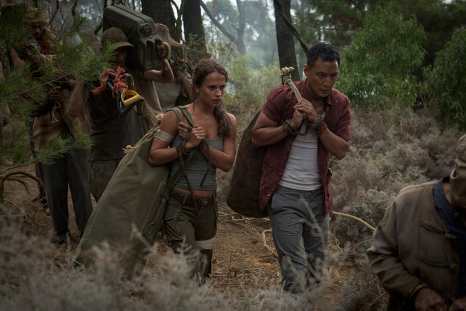"""(L-R) ALICIA VIKANDER as Lara Croft and DANIEL WU as Lu Ren and in Warner Bros. Pictures' and Metro-Goldwyn-Mayer Pictures' action adventure """"TOMB RAIDER,"""" a Warner Bros. Pictures release."""