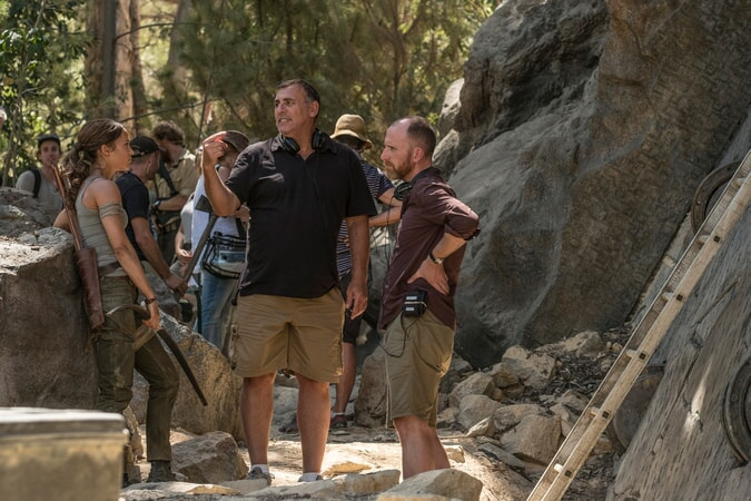 """(L-R) ALICIA VIKANDER, producer GRAHAM KING and director ROAR UTHAUG on the set of Warner Bros. Pictures' and Metro-Goldwyn-Mayer Pictures' action adventure """"TOMB RAIDER,"""" a Warner Bros. Pictures release."""