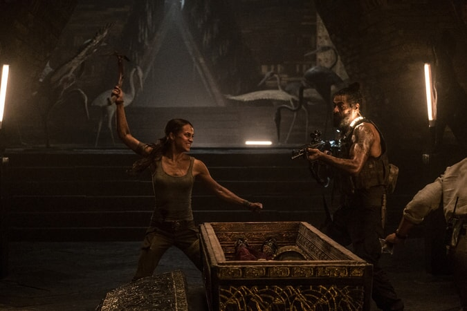 """(Left) ALICIA VIKANDER as Lara Croft in Warner Bros. Pictures' and Metro-Goldwyn-Mayer Pictures' action adventure """"TOMB RAIDER,"""" a Warner Bros. Pictures release."""