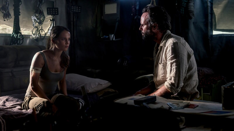 """(L-R) ALICIA VIKANDER as Lara Croft and WALTON GOGGINS as Mathias Vogel in Warner Bros. Pictures' and Metro-Goldwyn-Mayer Pictures' action adventure """"TOMB RAIDER,"""" a Warner Bros. Pictures release."""