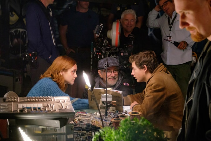 """(Center L-R) OLIVIA COOKE, director/producer STEVEN SPIELBERG and TYE SHERIDAN on the set of Warner Bros. Pictures', Amblin Entertainment's and Village Roadshow Pictures' action adventure """"READY PLAYER ONE,"""" a Warner Bros. Pictures release."""