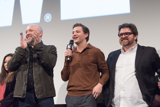 """(L-r) Screenwriter ZAK PENN with TYE SHERIDAN and co-screenwriter/author/co-producer ERNEST CLINE at SXSW 2018 in Austin, Texas for Warner Bros. Pictures,' Amblin Entertainment's and Village Roadshow Pictures' science fiction action adventure """"READY PLAYER ONE,"""" a Warner Bros. Pictures release."""