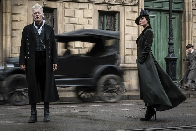 """JOHNNY DEPP as Gellert Grindelwald and POPPY CORBY-TUECH as Vinda Rosier, one of Grindelwald's most trusted followers, a loyal servant to his cause and often at his side, in Warner Bros. Pictures' fantasy adventure """"FANTASTIC BEASTS: THE CRIMES OF GRINDELWALD,"""" a Warner Bros. Pictures release. Photo by Jaap Buitendijk"""