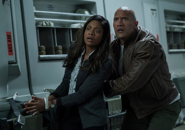 "NAOMIE HARRIS as Dr. Kate Caldwell and DWAYNE JOHNSON as Davis Okoye in New Line Cinema's and ASAP Entertainment's action adventure ""RAMPAGE,"" a Warner Bros. Pictures release."