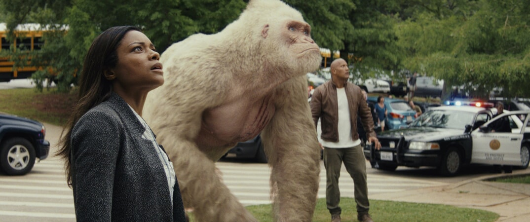 "(L-R) NAOMIE HARRIS as Dr. Kate Caldwell, JASON LILES as George and DWAYNE JOHNSON as Davis Okoye in New Line Cinema's and ASAP Entertainment's action adventure ""RAMPAGE,"" a Warner Bros. Pictures release."