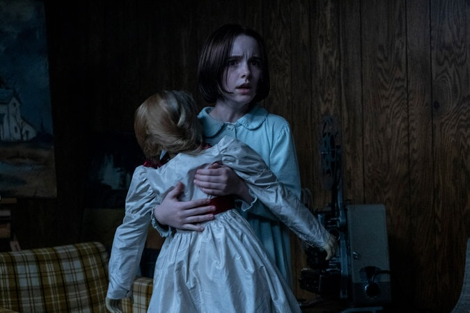 MCKENNA GRACE as Judy Warren with the Annabelle doll