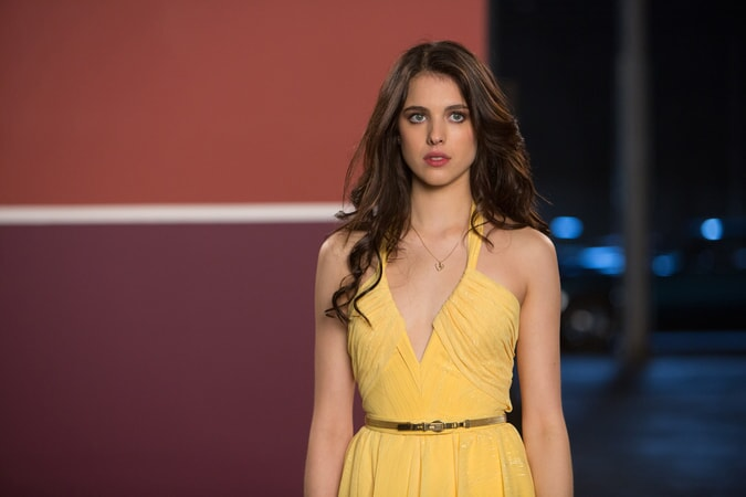 MARGARET QUALLEY as Amelia Kuttner wearing a yellow dress