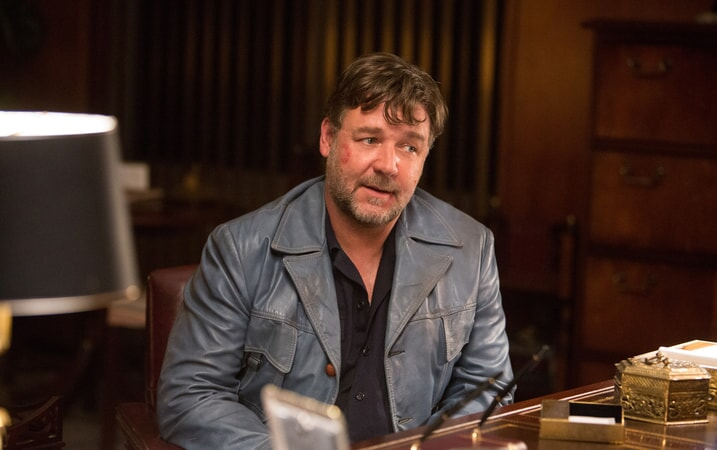 RUSSELL CROWE as Jackson Healy with a mark on his face, sitting at a desk