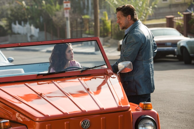 MARGARET QUALLEY as Amelia Kuttner parked but in driver's seat and RUSSELL CROWE as Jackson Healy standing next to her