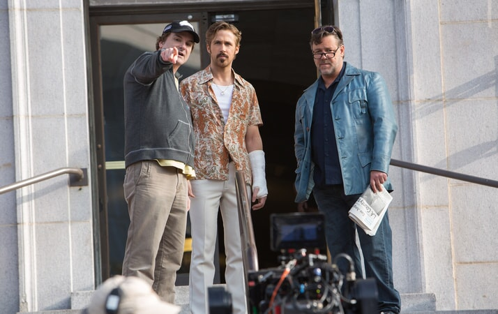 Writer/director SHANE BLACK, RYAN GOSLING and RUSSELL CROWE on the set of The Nice Guys