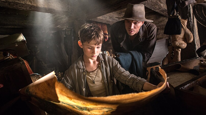 "LEVI MILLER as Peter and GARRETT HEDLUND as James Hook in Warner Bros. Pictures' action adventure ""PAN,"" a Warner Bros. Pictures release."