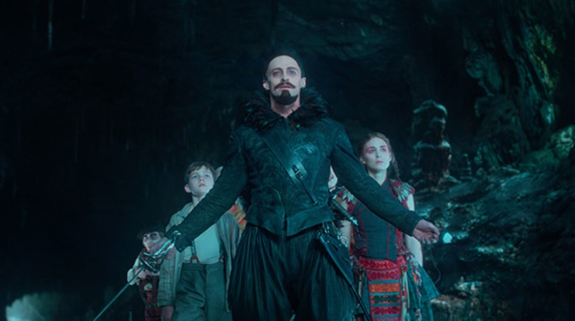 "LEVI MILLER as Peter, HUGH JACKMAN as Blackbeard and ROONEY MARA as Tiger Lily in Warner Bros. Pictures' and RatPac-Dune Entertainment's action adventure ""PAN,"" a Warner Bros. Pictures release."