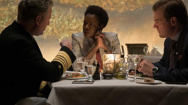 Viola Davis as Amanda Waller at dinner