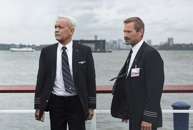 """TOM HANKS as Chesley """"Sully"""" Sullenberger and AARON ECKHART as Jeff Skiles"""