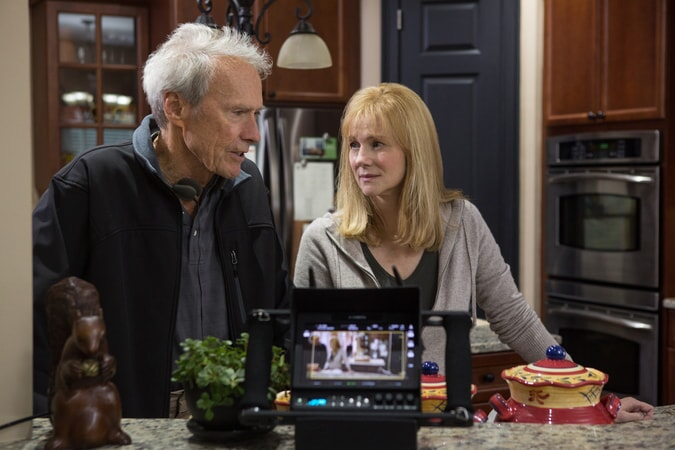 """CLINT EASTWOOD and LAURA LINNEY on the set of Warner Bros. Pictures' and Village Roadshow Pictures' drama """"SULLY,"""" a Warner Bros. Pictures release."""