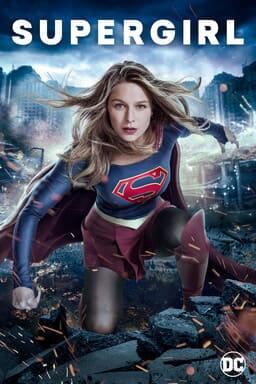 Melissa Benoist as Supergirl kneeling in debris of city destruction